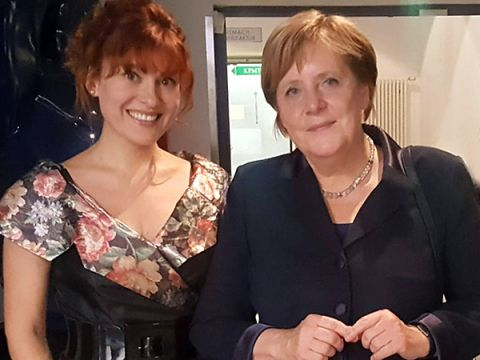 Pianist Yuliya Drogalova and Angela Merkel, Chancellor of the Federal Republic of Germany, stand side by side
